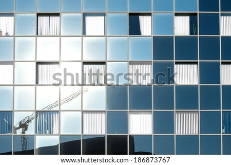 Texture of a general building outdoors with many windows - stock photo