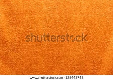 texture of an orange bath towel - stock photo