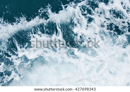 Texture of beautiful wave in the ocean. - stock photo
