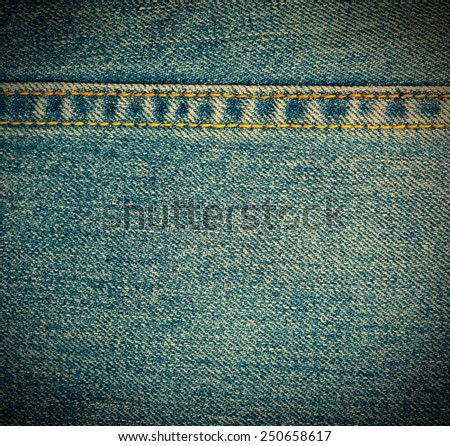 Texture of blue jeans background with horizontal stitch, close up. instagram image retro style - stock photo