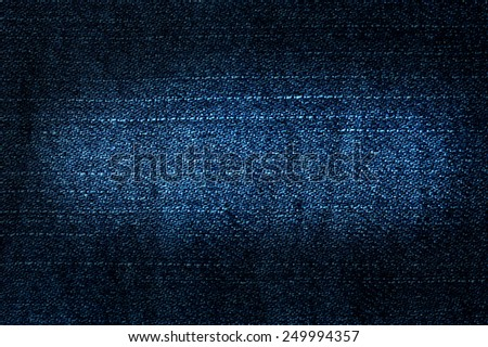 Texture of blue jeans textile close up - stock photo