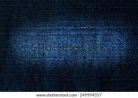 Texture of blue jeans textile close up - stock photo