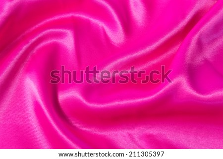 texture of bright, acid pink fabric with folds - stock photo