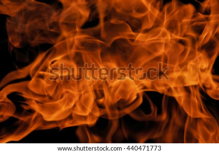 Texture of bright fire flames on a black background - stock photo