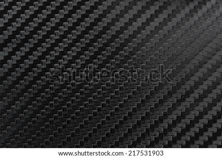 Texture of Carbon Kevlar Fiber material. Dark background. - stock photo