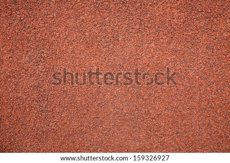 Texture of color rubber floor on Stadium. - stock photo