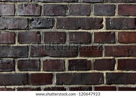 Texture of dark old brickwork - stock photo