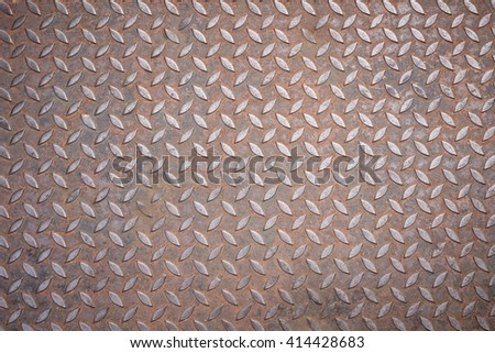 Texture of diamond plate rusty metal for background - stock photo