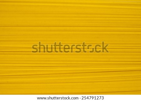 Texture of dry uncooked spaghetti background. - stock photo