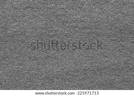texture of fabric with knitted drawing in the form of loops for abstract backgrounds of black color - stock photo