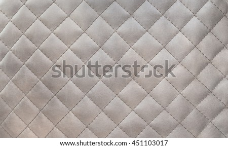 Texture of genuine leather upholstered furniture. Decorative background - stock photo