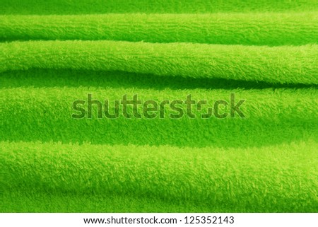 texture of green terry towel with folds - stock photo