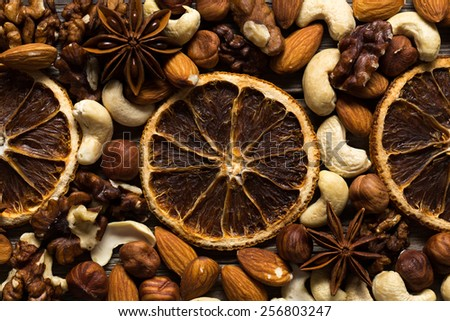 Texture of herbs and spices. View from top. Dried nuts, oranges and spices. - stock photo