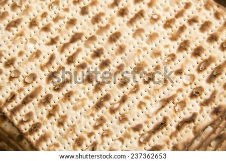 Texture of jewish passover matzah (unleavened bread) - stock photo