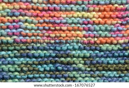 Texture of knitting wool in green, blue, yellow, red, pink and orange color - stock photo