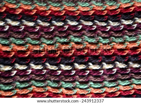 Texture of knitting wool in green, orange, brown, red, black and white color - stock photo
