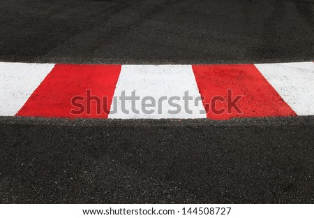 Texture of motor race asphalt and re white curb. Close up on Monaco Montecarlo Grand Prix street circuit - stock photo