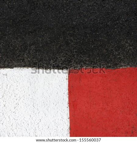Texture of motor race asphalt and re white curb. Close up on Monaco Montecarlo Grand Prix street circuit - stock photo