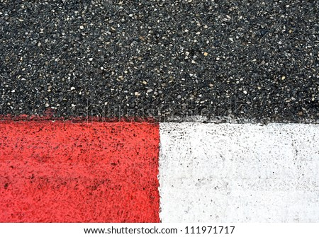 Texture of motor race asphalt and red white curb. Close up on Monaco Montecarlo Grand Prix street circuit - stock photo