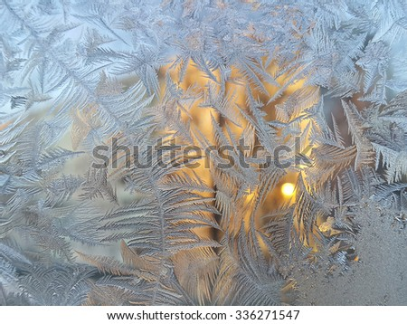 Texture of natural ice pattern and sunlight on winter glass - stock photo
