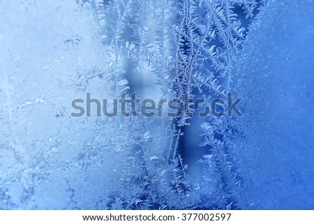 Texture of natural ice pattern on winter glass - stock photo