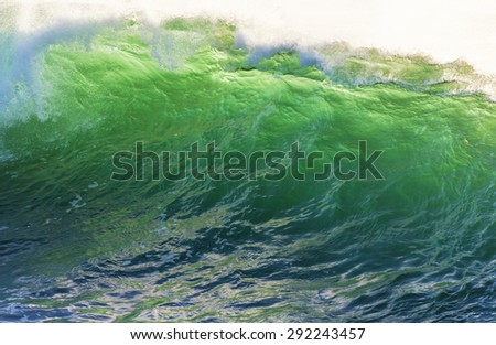 Texture of Ocean wave at sunset time. - stock photo