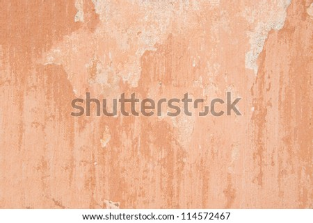 Texture of red plaster on wall - stock photo