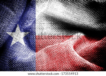Texture of sackcloth with the image of the Texas Flag. - stock photo