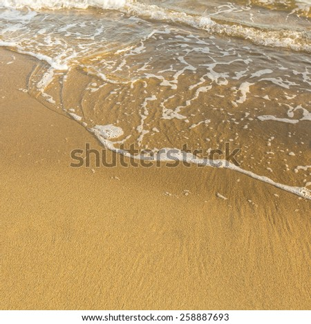 Texture of sand beach sea, soft wave of surf. - stock photo
