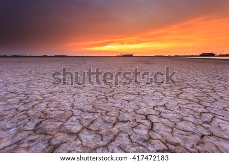 Texture of soil and beautiful sunset  - stock photo