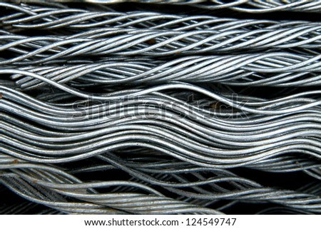 Texture of steel wire for armor rod cable - stock photo