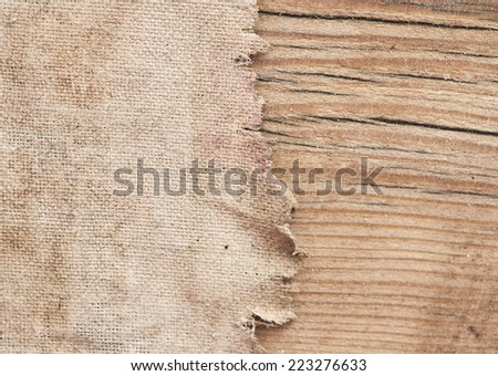 Texture of the burlap and old wood  - stock photo