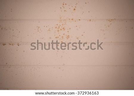 Texture of the desert sand metal door of a garage background - stock photo