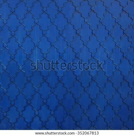 Texture of the old blue metal door Kremlin, Kazan, Tatarstan, Russia. - stock photo