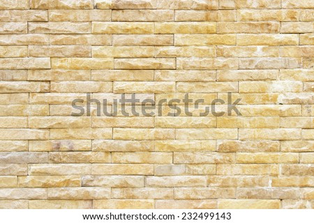 texture of the old sandstone wall for background,Sandstone wall background,Pattern of Sandstone Brick Wall Surfaced - stock photo