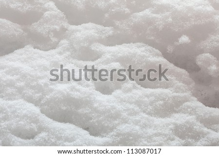 texture of the snow on a sunny day in backlit - stock photo