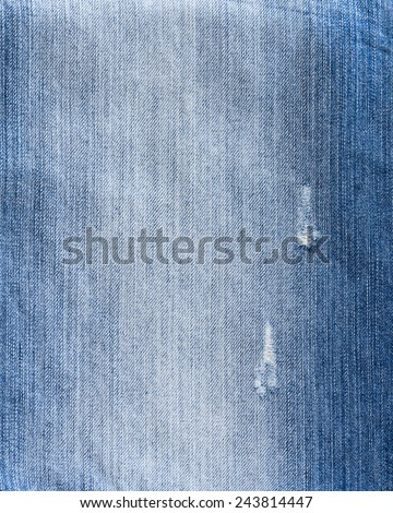 Texture of threadbare denim of indigo color - stock photo
