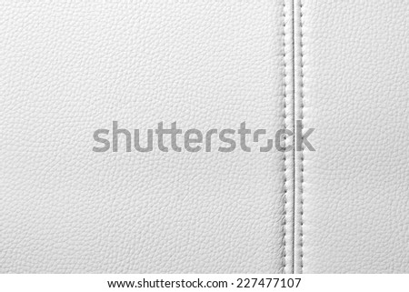 Texture of white leather, seam, close-up - stock photo