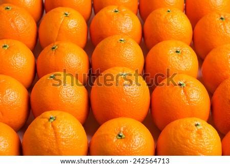 Texture of whole oranges. Oranges close-up. - stock photo