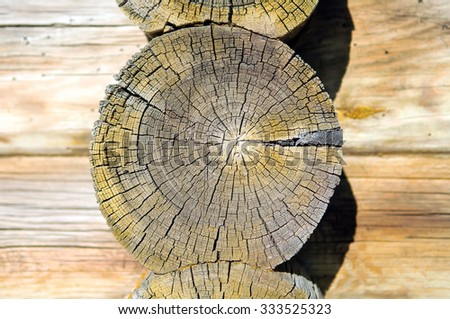Texture of wood, cut of wood, texture of the wooden frame house, village house, parts of log house, North village, North house,  old log cabin. - stock photo
