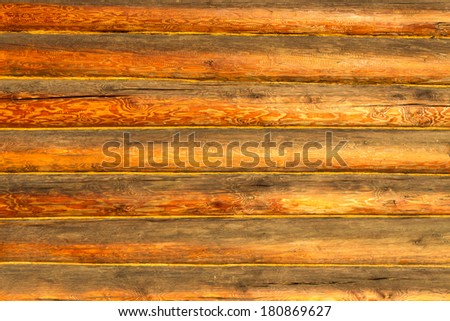 Texture of wooden wall of log cabin - stock photo