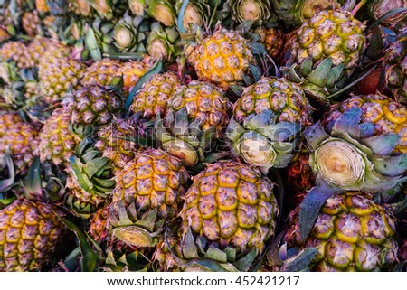 Texture pile of famous pineapple in northern Thailand - stock photo