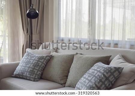Texture pillows on beige sofa in modern living room - stock photo