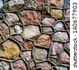 Texture. Stone wall made of stones of different shapes - stock photo