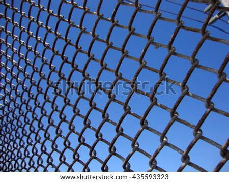 Texture the cage metal net at angle with powerlines. - stock photo