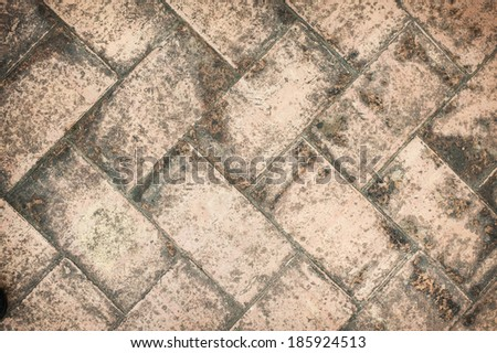 texture tile flooring crossed, aging effect by bad weather - stock photo