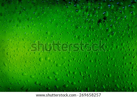 Texture water drops on the bottle of beer. Beer background - stock photo
