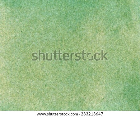 Textured aged rough grainy green vintage paper retro background - stock photo