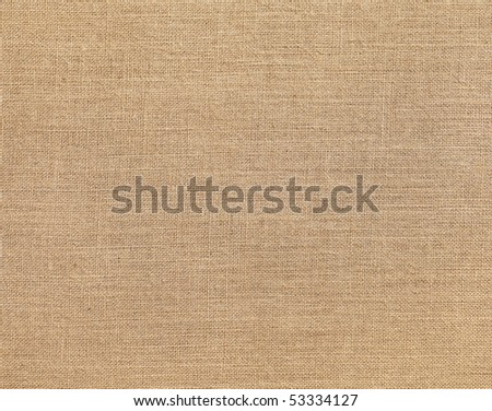 Textured background of a sandy brown burlap cloth - stock photo