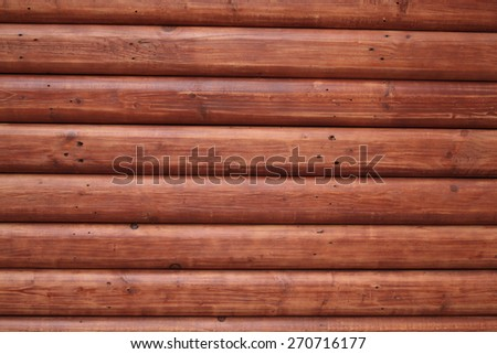 Textured background of new red wooden trunk wall - stock photo